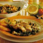 Geschmorte Tintenfischringe mit Gemüse
